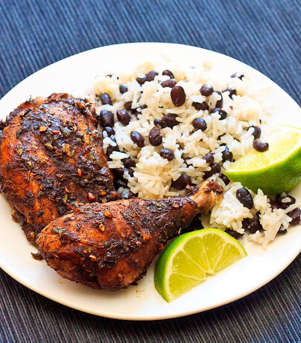 Serve jerk chicken with coconut rice and beans and lime wedges.